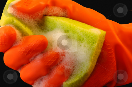 Cleaning power stock photo, Soapy sponge held by a hand in an orange protective glove by Andreas Karelias