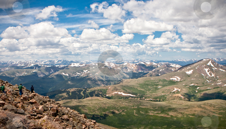 Hiking a 14000 foot mountain stock photo, Three hikers climbing down from a 14000 foot mountain peak in Colorado by Sharon Arnoldi