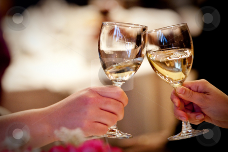 Cheers, two glasses clinked together stock photo, Two wine glasses clinked together in celebration by Sharon Arnoldi