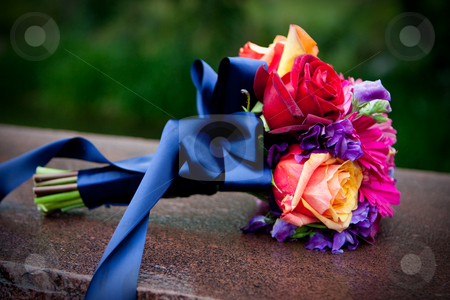 A bouquet of flowers with a blue ribbon stock photo, A bouquet of flowers with a blue ribbon wrapped around them with an out of focus background by Sharon Arnoldi
