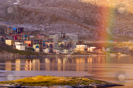 Qinngorput, Greenland stock photo, The modern part of Nuuk city, Greenland, Qinngorput bathed in the evening sunshine and hit by the end of a colorful rainbow by Anders Peter