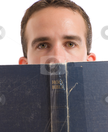 Man Reading Bible stock photo, A young man reading his bible with hald his head behind it, isolated against a white background by Richard Nelson