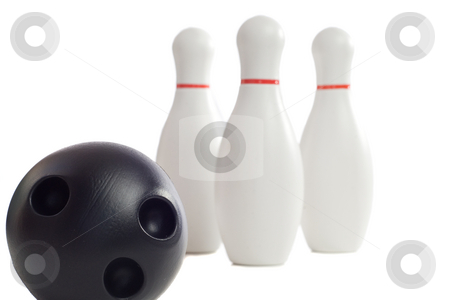 Child's Bowling Toys stock photo, A plastic bowling ball rolling towards three pins, isolated against a white background by Richard Nelson