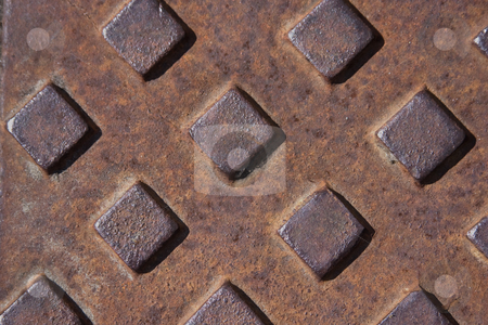 Rusty cover stock photo, Close up of a rusting water meter cover by Darren Pattterson