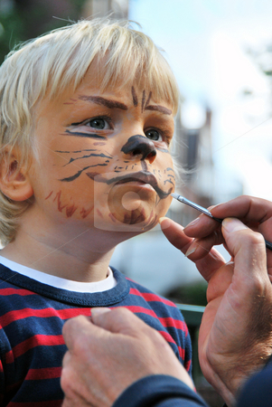The making of a lion stock photo, The face of a young child being made to look like a ferocious lion by a make-up artitst by Corepics VOF
