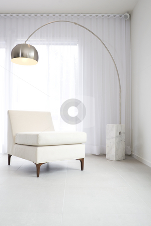 Contemporary interior with lamp stock photo, Contemporary interior with designer lamp and chair by Jodie Johnson