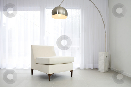 Contemporary interior with lamp and chair stock photo, Contemporary interior with designer lamp and chair by Jodie Johnson
