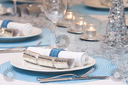 Christmas dinner table stock photo, Close-up of a stunning contemporary chirstmas dinner table setting by Jodie Johnson