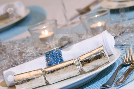 Christmas dinner table setting stock photo, Christmas dinner table setting in blue, white & silver by Jodie Johnson