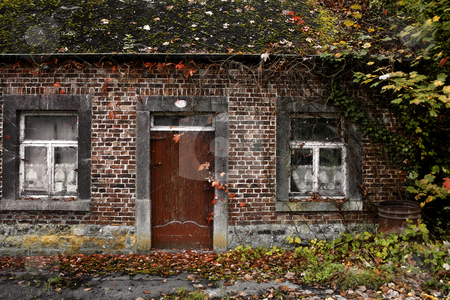 Old house in decay stock photo, Front of old dirty home in autumn by Wino Evertz