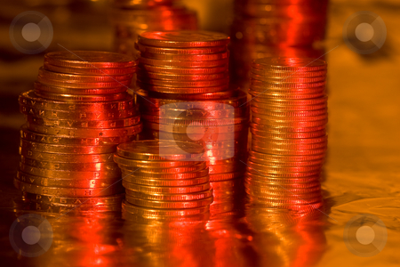 Coins stock photo, Money series: heap of coins orreflective surface by Gennady Kravetsky
