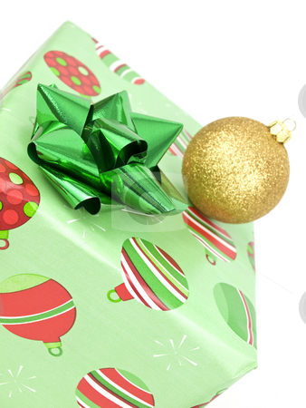 Close up of present with bauble stock photo, Close up of present with bauble on white background by John Teeter
