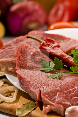 Raw meat stock photo, Macro picture of meat and vegetables on the wood board by Gennady Kravetsky