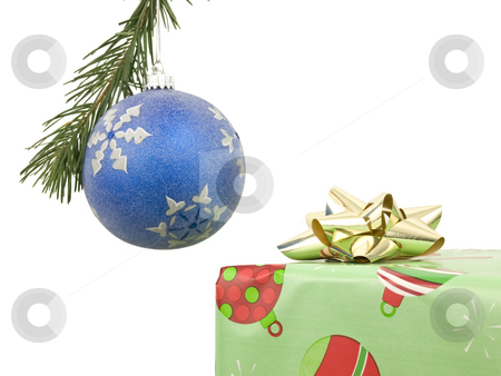 Bauble and present stock photo, Bauble and christmas present on white background by John Teeter