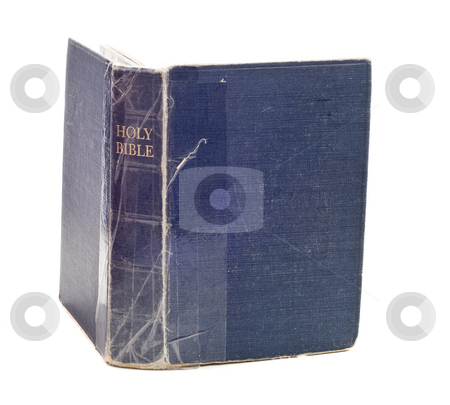 Isolated Bible stock photo, An old blue bible is being held together with tape and isolated against a white background by Richard Nelson