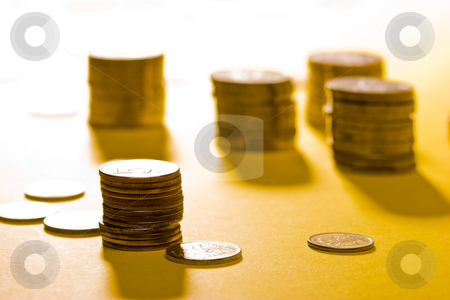 Coins stock photo, Money series: coins on the yellow background by Gennady Kravetsky