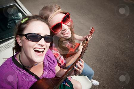 Fem stock photo, Female Musicians on an Old Car by Scott Griessel