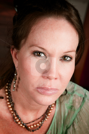 Pretty woman with stern expression stock photo, Pretty woman with stern expression on her face by Scott Griessel