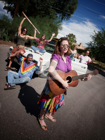 Groovy group with female Singer stock photo, Group of hippies with female guitar player by Scott Griessel
