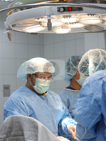 Male asian surgeons stock photo,  by Claro Alindogan