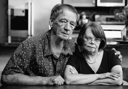 Couple at Home stock photo, Senior couple at a table in their modern kitchen by Scott Griessel
