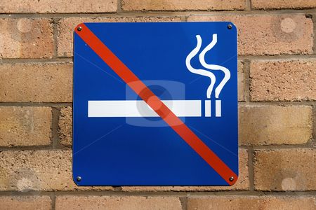 No Smoking stock photo, Blue no smoking sign on a red brick wall by Darren Pattterson