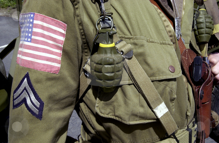 American world war two GI soldier stock photo, Details of American World War two GI soldier wearing army uniform with hand grenades and corporal stripes. by Martin Crowdy