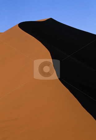 Desert sand dunes stock photo, Scenic view of sand dune in Sahara desert with blue sky and shadow. by Martin Crowdy