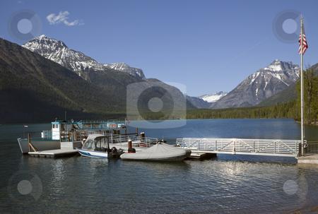 Lake McDonald Boats Glacier National Park stock photo, Lake McDonald Boats Snow Mountains at Glacier National Park by William Perry