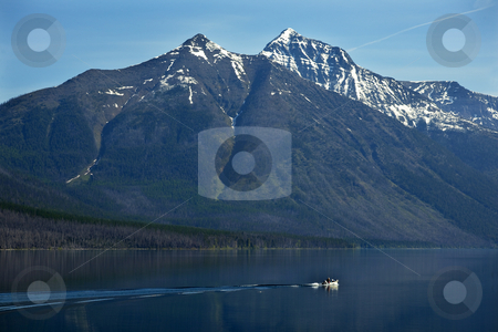 Lake McDonald Fishing Boat Glacier National Park Montana stock photo, Lake McDonald Going Fishing Outboard in front of Snow Mountain Glacier National Park Montana by William Perry