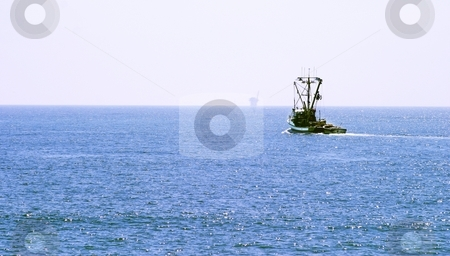 Fishing Boat stock photo, Fishing Boat out on the ocean on a clear day by Henrik Lehnerer