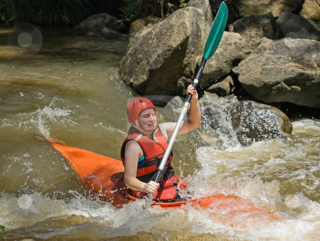 White water kayaking stock photo, Great image of a teenage facing the ordeals and challenge of white water kayaking by Phil Morley