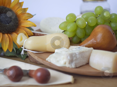 Cheese and fruit stock photo, Table with several kind of cheese, pear, grape by Fabio Alcini
