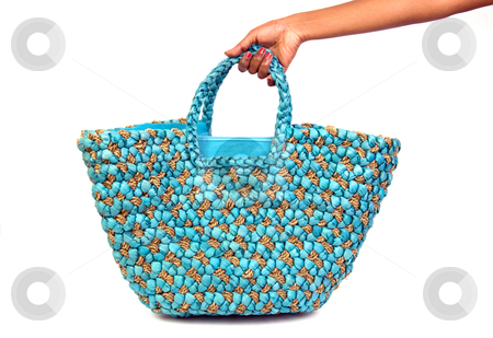 Summer-bag-lady/ Description: A woman's hand holding a colorful summer