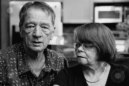Worried Senior Couple stock photo, Worried Senior Couple at Home in Modern  Kitchen by Scott Griessel