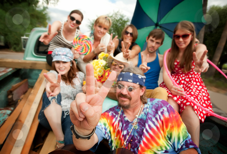 Groovy Group in the Back of Truck stock photo, Groovy Group in the Back of Truck Making Peace Signs by Scott Griessel