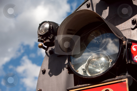 Light on the Front of Train stock photo, Light on the front of vintage steam engine train by Scott Griessel