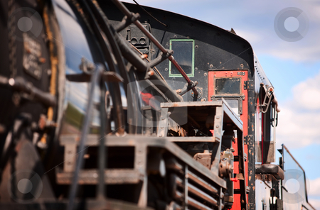 Train Engine stock photo, Steam engine cab on vintage passenger train by Scott Griessel