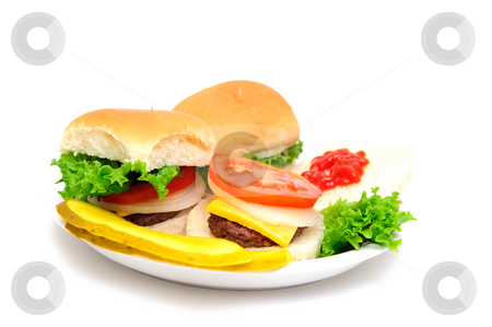 Mini-hamburgers stock photo, Three mini-burgers topped with cheddar cheese, white onion, tomato and lettuce on a white plate with sliced dill pickels on the side isolate on a white background by Lynn Bendickson