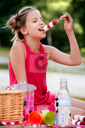Eating a strawberry stock photo, Teenagers having a great time in the park by Frenk and Danielle Kaufmann