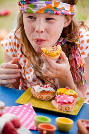 Happy eating cupcake girl stock photo, Teenagers having a great time in the park by Frenk and Danielle Kaufmann