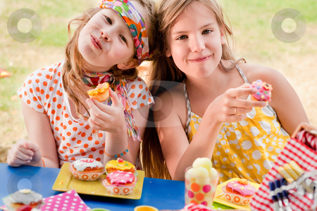 Cupcake girlfriends stock photo, Teenagers having a great time in the park by Frenk and Danielle Kaufmann