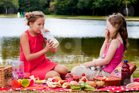 Drinking some milk stock photo, Teenagers having a great time in the park by Frenk and Danielle Kaufmann