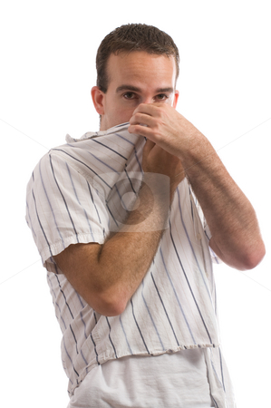 Bad Smell stock photo, A young man holding his nose because of a bad smell, isolated against a white background by Richard Nelson