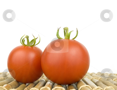 Two Ripe Tomatoes stock photo, Two Ripe Tomatoes on bamboo with white background by John Teeter