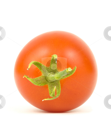Tomato on white stock photo, Single ripe tomato on a white background by John Teeter