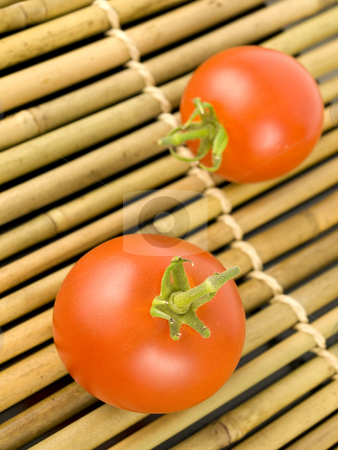 Two Tomatoes on Bamboo stock photo, Two tomatoes on a wooden bamboo background by John Teeter