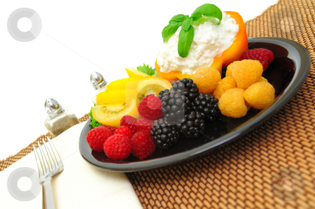Berry And Cottage Cheese Salad stock photo, Lo-cal salad made with red and golden raspberries, blackberries, yellow heirloom tomatoes with an orange bell pepper filled with cottage cheese topped with fresh basil by Lynn Bendickson