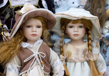 Delicate Dolls stock photo, Two pretty dolls on display by Lee Torrens