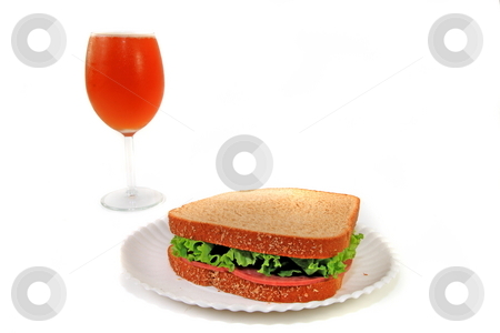 Lunch stock photo, Beer in a wine glass and a sandwich on a paper plate by Jack Schiffer